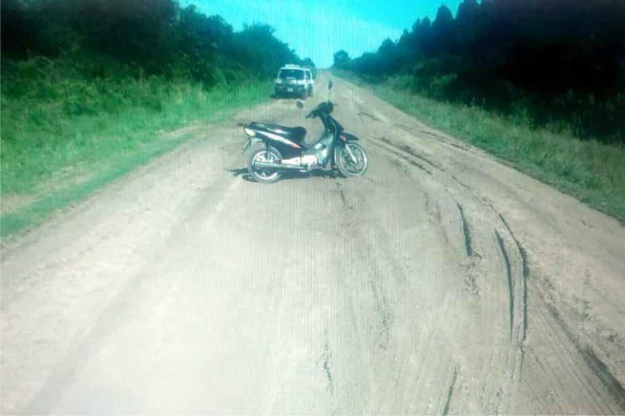 Muerto al lado de su moto